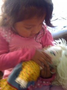Little girl inspects Melodie Mezoree' doll