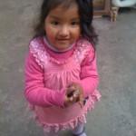 LIttle girl in downtown, Cusco Peru